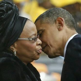 Obama awkward kiss for Nelson Mandela's widow Graca Machel