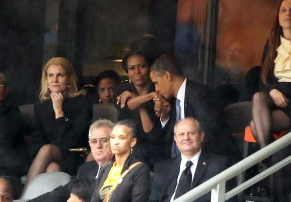 Obama kisses Michelle Obama's hand at Nelson Mandela memorial