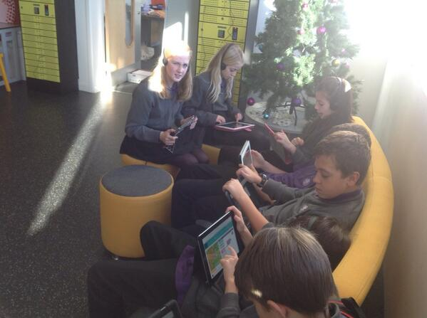 Coding by the Christmas tree at @sl_academy #HourOfCode #teachHOC Next coding Christmas cards with @khanacademy http://t.co/PnZOOO9X0P