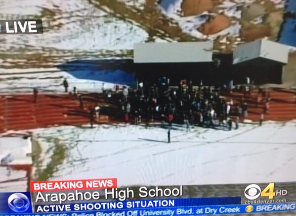 Copter4 showing large group of students evacuated outside Arapahoe HS. http://t.co/z7d3xro26P
