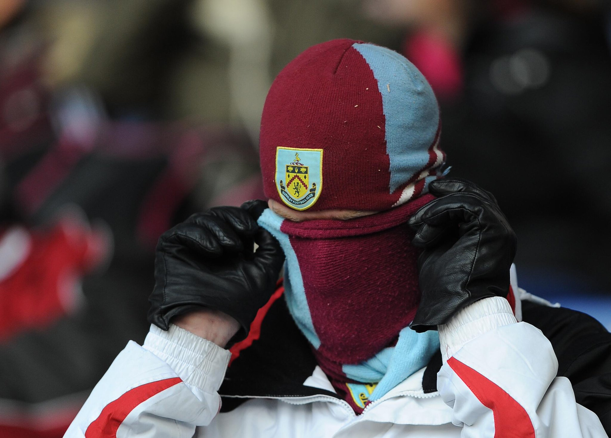 A Burnley fan takes keeping warm to a new level at Leicester