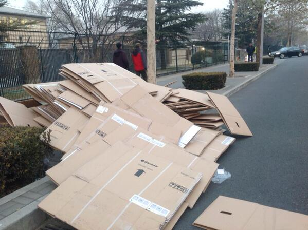 Achtung. Dozens of air purifiers' cardboard boxes in front of German embassy in Beijing today http://t.co/7TiaN8sQ9V