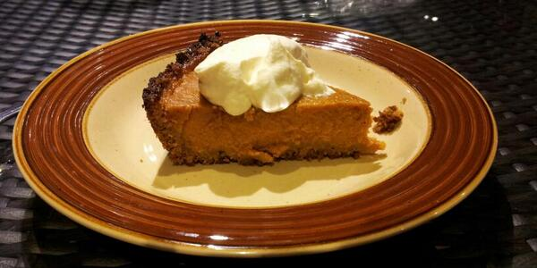 Pumpkin pie in gingersnap cookie crust with maple whipped cream