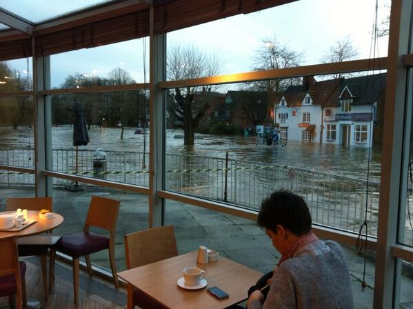 Debenhams in Guildford only a foot away from flooding. Submerged cars in background. #ukstorm @BBCSurrey http://t.co/fQk1qUa8Ba