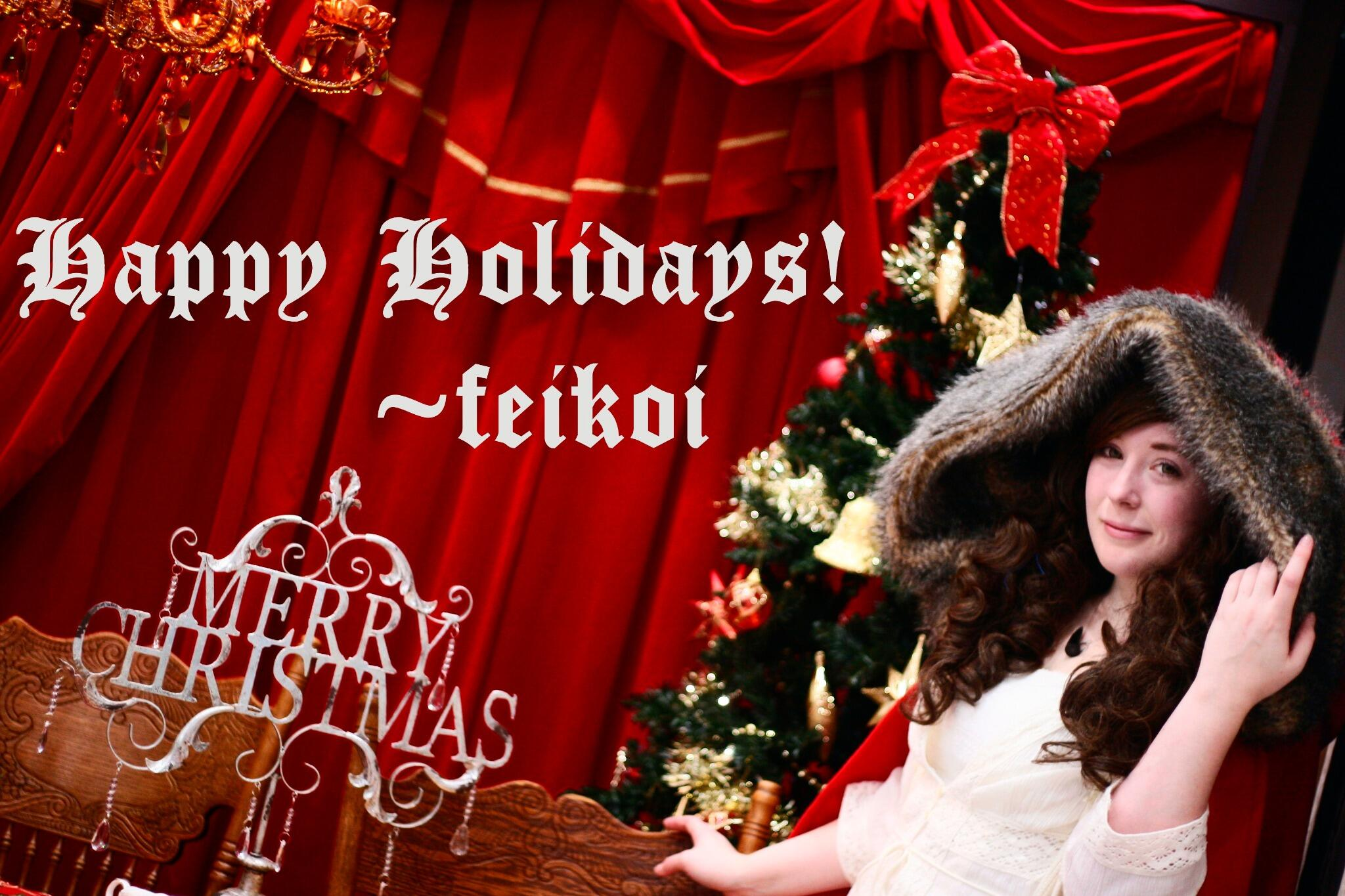 "red riding hood cosplay with a holiday backdrop, reads ""Happy Holidays"""