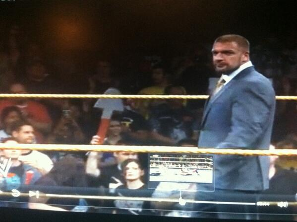 A guy with a shovel in the nxt crowd while triple h was out there haha this was funny
