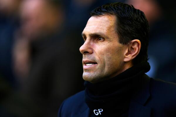 Awful! Sunderland boss Gus Poyet sports a personalised snood during Everton v Sunderland [Picture]