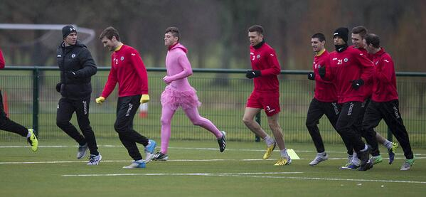 Partick Thistles Gary Fraser wears a pink leotard & tutu at training after losing a forfeit [Pictures]
