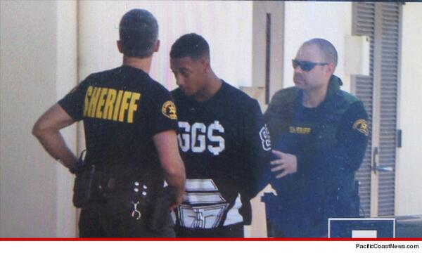Pls tell me Justin Bieber's friend Lil Za isn't wearing a shirt that says EGGS on it during a house raid lookn 4 eggs http://t.co/rfbbi87f1u