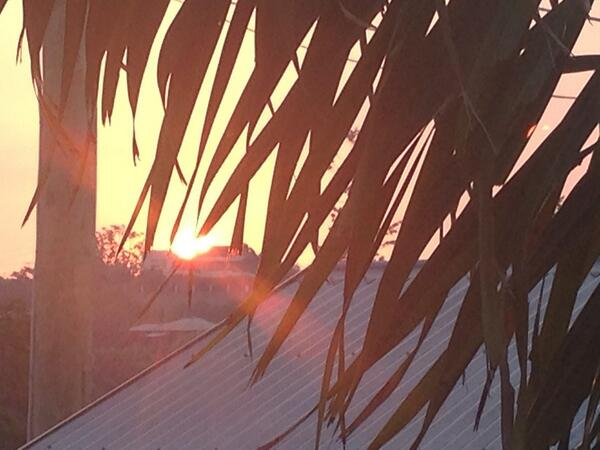 Sun glows red over Brisbane's tin roofs ...smoke from Straddie fires http://t.co/ckWI2tT2lH