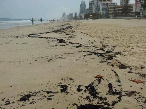Ash from Stradbroke Island fires washes up on Surfers Paradise beach [6/1/14] http://t.co/w1oR3vQIf9