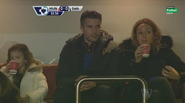 Glum Robin van Persie in the stands during Man United v Swansea