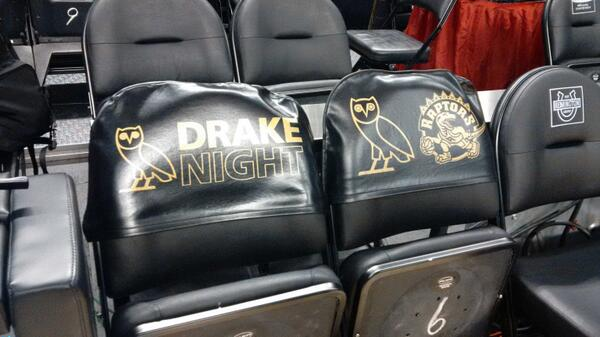 "For those asking ""will Drake be in attendance?"" ... yes. He's got his own seat-backs at his courtside chairs.  #rtz http://t.co/nLJWwxpmEF"