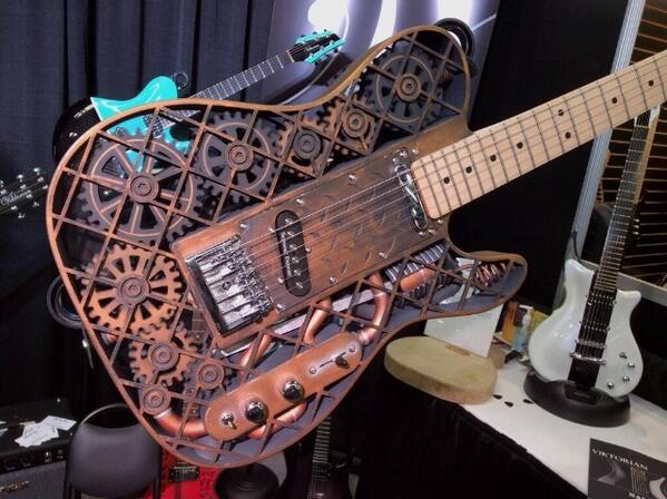 Check out this 3D-printed Steampunk guitar at #NAMM. Stopped Lee dead in his tracks #HolyShit! http://t.co/mSnrP08ToW