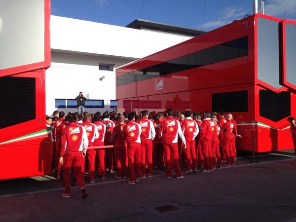 Ferrari team lines up in the pitlane to wish Schumacher well http://t.co/RqlA93NiA5