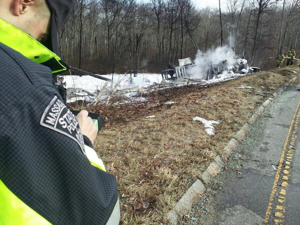 A member of the State Police Collision Reconstruction and Analysis Team at work at the Rt24 tanker crash scene. http://t.co/Q9co6SRuvQ