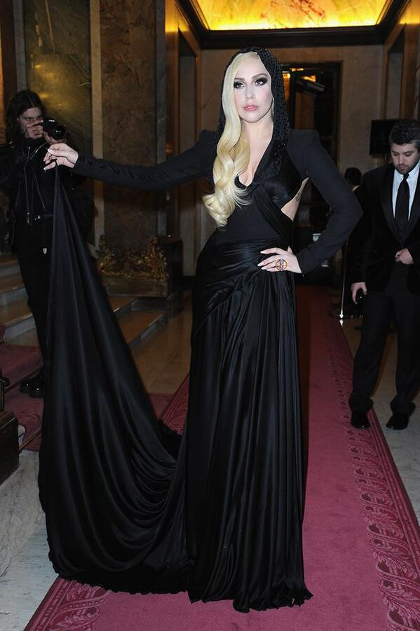 Gorgeous @ladygaga sat front row in a hooded draped gown at the #AtelierVersace SS14 show Paris #VersaceLovesGaga http://t.co/1JV5Z3Z2Ix
