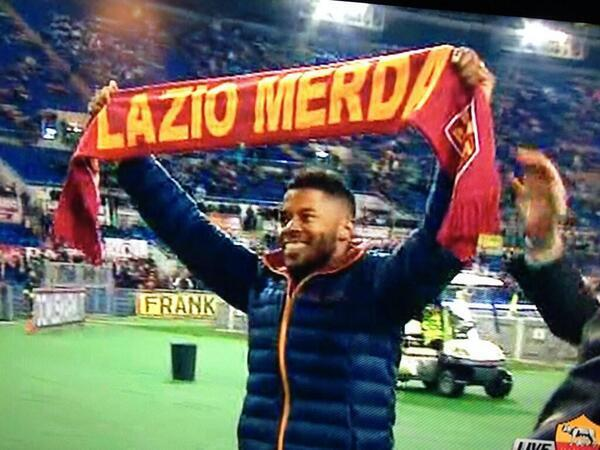 New signing Michel Bastos presented to Roma fans with Lazio Sh** scarf