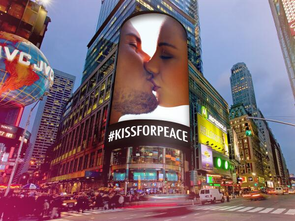 Pucker up for the cameras. Post your #KissForPeace and we'll share it with the world in Times Square. http://t.co/qIUG9yFc9W