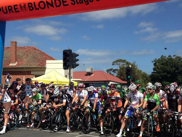 Riders lined up at the start line for Pure Blonde Stage 5 of #TDU. The flag is down and the heat is on. http://t.co/s4sHpKYrul