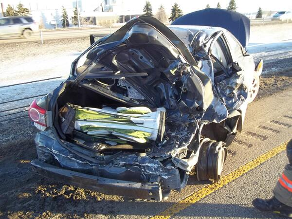 RCMP need solving hit and run on QE2 near Red Deer-transport truck hit a small car, dragged it, then took off. #yyc http://t.co/UuMSv2Jqg4
