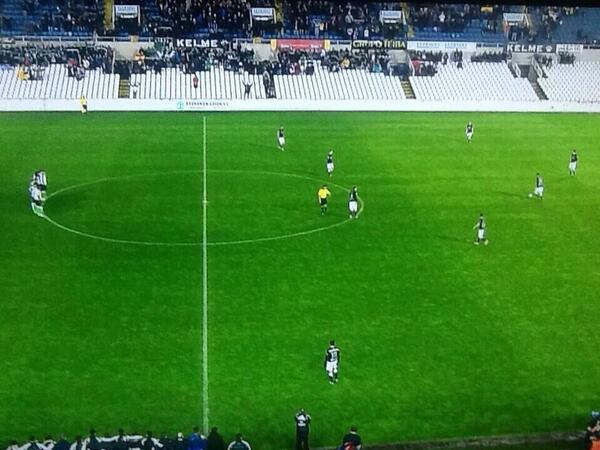 Racing Santanders players unite on centre circle at kick off and refuse to play v Sociedad