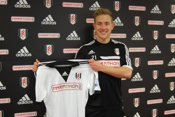 Lewis Holtby poses with the Fulham shirt following loan move from Tottenham