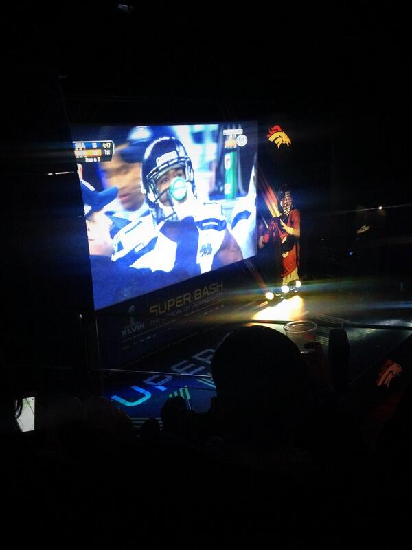Watching the #SuperBowlXLVIII at the @nfl_uk #superbash - who's everyone supporting? #Seahawks #Broncos http://t.co/wf45DjbYxR