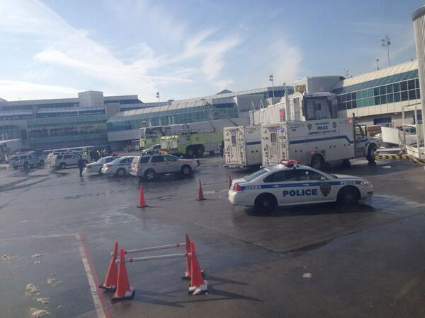 "UPDATE: LaGuardia terminal evacuated after report of ""smoking"" bag http://t.co/uinif6afi3 (Photo: Robert Kloss) http://t.co/IQ1R6pRBIB"
