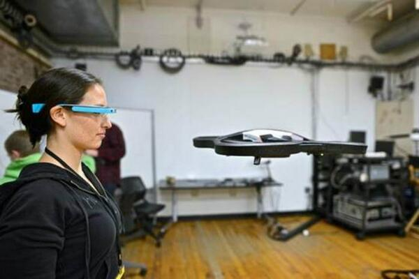 A participant controls an #ARDrone using #Googleglass at @NodeCopter Read more ->> http://t.co/PheIS8bVHU http://t.co/qAVcDDiGpT
