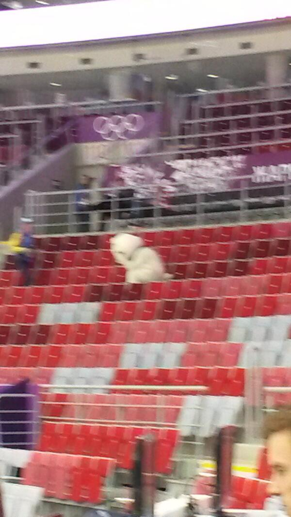 This Sochi bear, head in his paws, sits alone in Bolshoi Ice Dome more than an hour after Russia's loss to Finland: http://t.co/apFQ4JhgKt