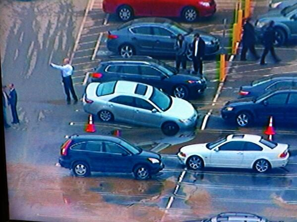 Car appears to be sinking in the Burlington Mall parking lot.. #Fox25 http://t.co/fXxvlZgyqp