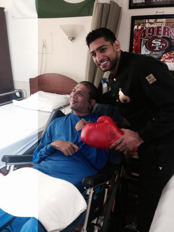 @AmirKingKhan with a patient who unfortunately hit by a drunk driver 8yrs ago paralysed but smiles with seeing Amir http://t.co/AYF59jktxY
