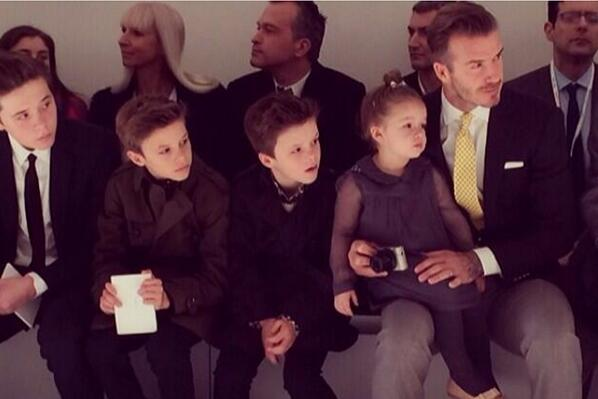 The Beckham family enjoying the @victoriabeckham AW14 fashion show. http://t.co/4oBUldo9tc