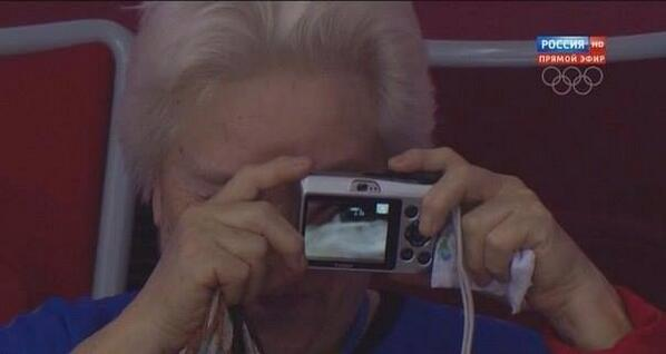 :))) RT @bryanwx: A woman attempting to take a picture at a hockey game in Sochi today. http://t.co/xPAHQ2s2ZZ