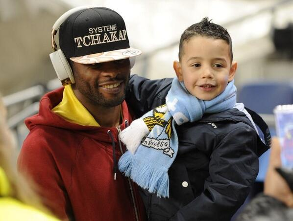 Top Man! Alex Song takes time out to take picture with young Man City fan at the Etihad