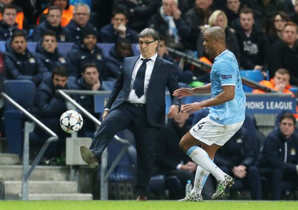 Suited Barcelona coach Tata Martino showed his tekkers on the sideline