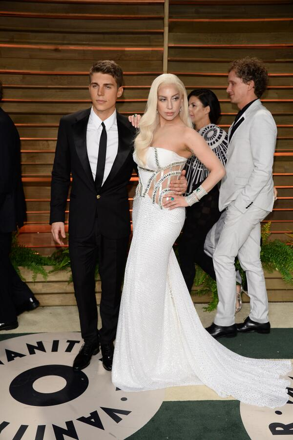 The stunning duo @nolanfunk & @LadyGaga at the Vanity Fair After Party both wearing Versace & #AtelierVersace http://t.co/MULwnFd4dD