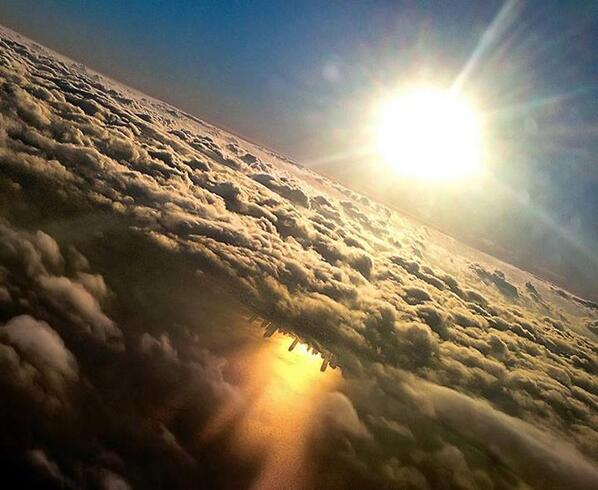 Stunning - approaching @fly2ohare, the shadow of the @Chicago skyline reflects off Lake Michigan, beneath the clouds: http://t.co/FsUEaOSmWr