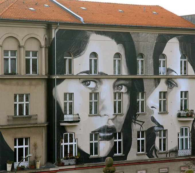 We love this multi-storied #mural by artist RONE in Berlin http://t.co/c7WBsmHwE4