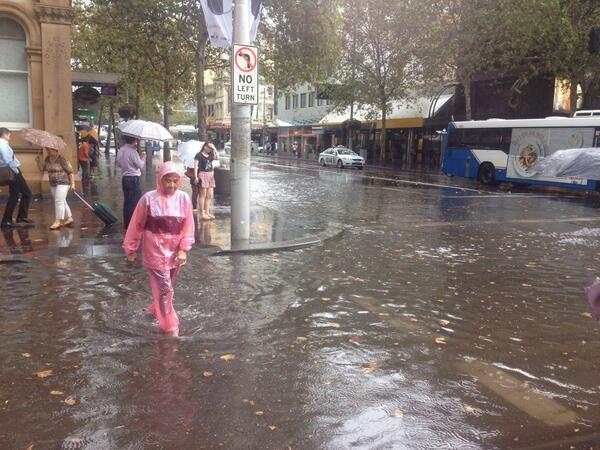 People wading through the temporary river on Hay and George Street #SydneyStorm http://t.co/Bbw7cOTOgO