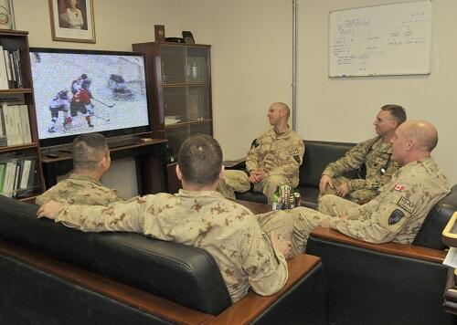 Canadian & US soldiers together w/cmdr NTM-A, MGen Milner, watch the semi-final mens Olympic hockey game. #sochi2014 http://t.co/b4yCihD5Ye