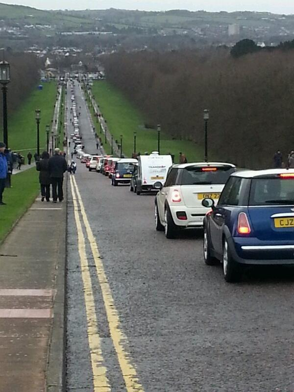 A mile of Minis and other iconic rally cars at Stormont to celebrate 50 years since Paddy Hopkirk won the Monte. http://t.co/H4cZMZMPeK