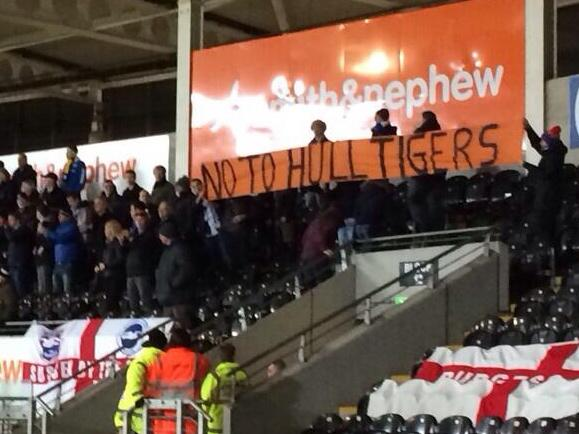 Awesome! Brighton away fans display a No to Hull Tigers banner in the away end at Hull [Picture]