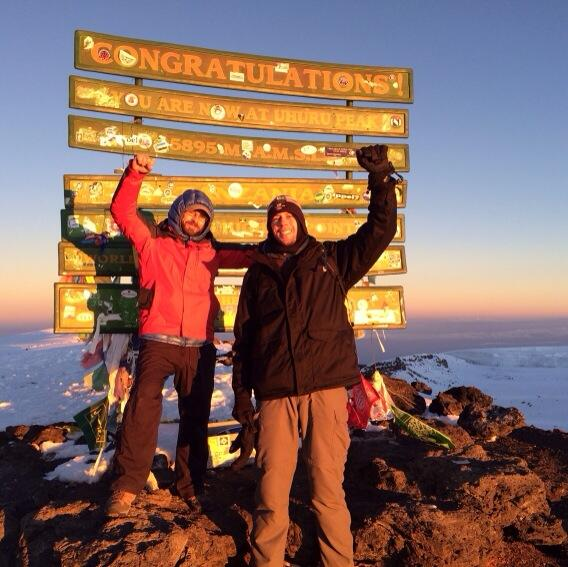 Photographic proof of @Luccrazy and I at the summit of Kilimanjaro -- Uhuru's Peak (5895m or 19,341 feet). http://t.co/G8mQ0EvlMx