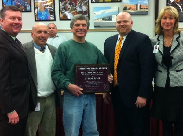 Teacher and drama coach H. Todd Kelly, center, with the plaque naming the #Pottsgrove HS stage after him. #PGSB http://t.co/l42KONW1ZP