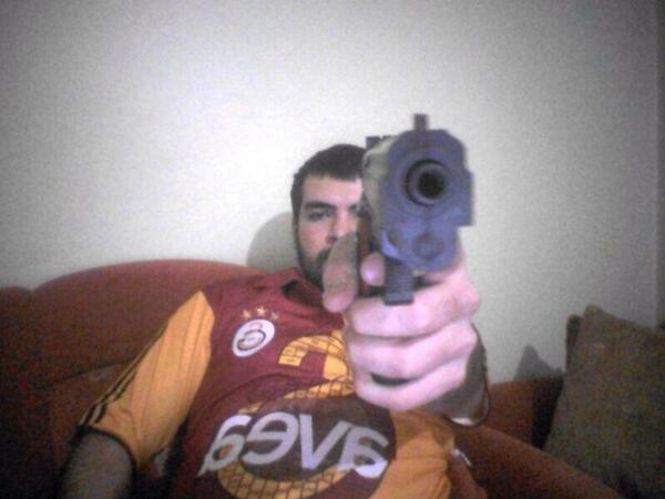 SHOCKING: A Galatasaray fan replied to a tweet by a Chelsea fan by pulling out a gun [Picture]