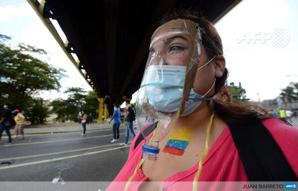 A woman wears a makeshift gas mask as anti-government demonstrators protest in Caracas, Venezuela, by @jbarreto1974 http://t.co/BhfTL1B0As