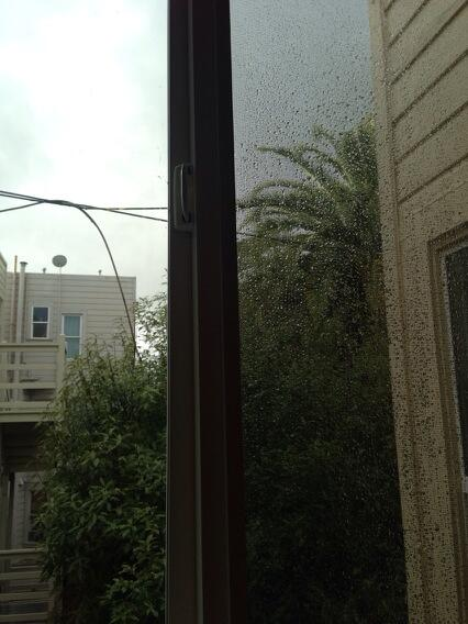 There's a glimmer of sun out my window, but rain lingers on the screen. Leaving early for my commute. #bayarearain http://t.co/iwDDtJC1Wu