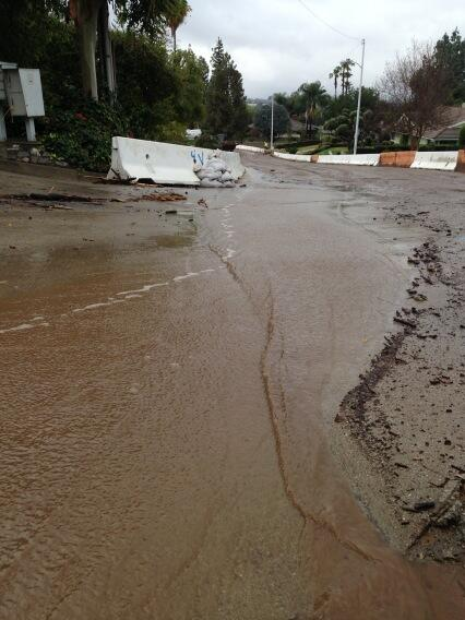It is a muddy mess with water still flowing down Rainbow Dr in #Glendora with more rain to come. #LARain @knx1070 http://t.co/GNyEzcOAOe